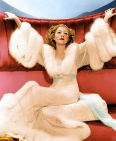 Joan Crawford crushing boudoir wear